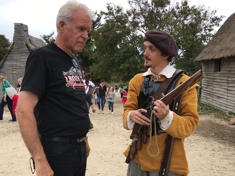 Man Demonstrating Old Flintlock Gun
