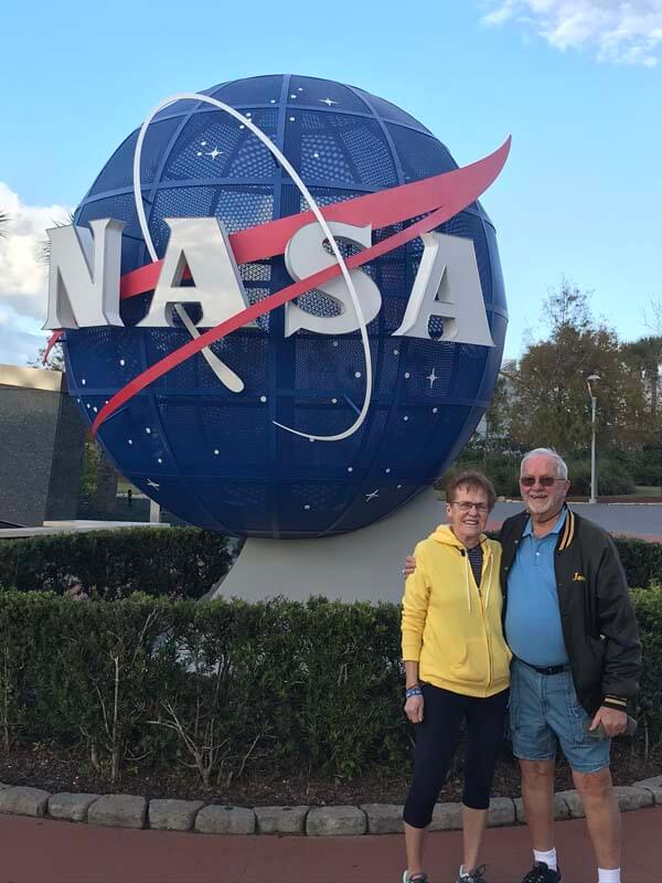 Couple standing in front of NASA sign