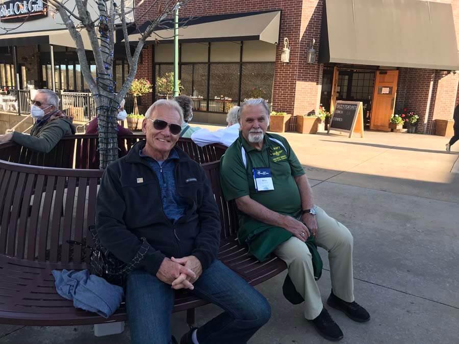 Two men sittin on bench